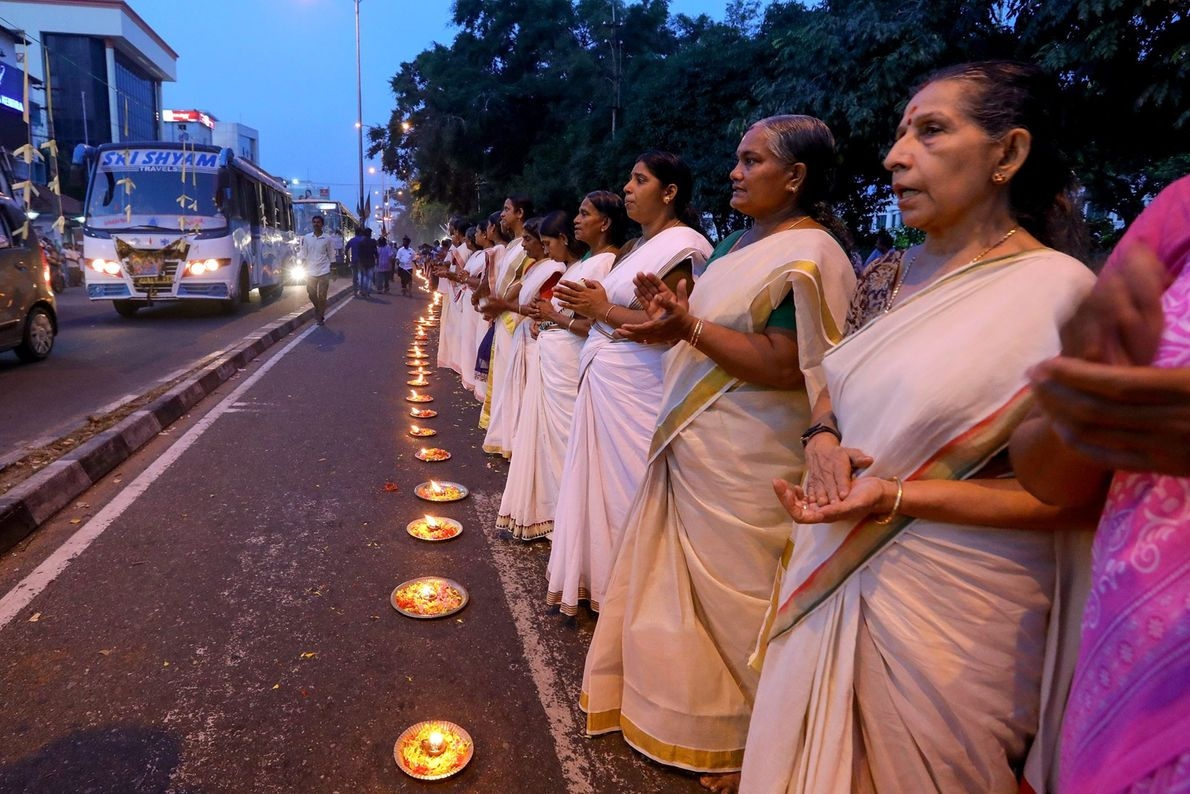 Women hold a roadside vigil in protest against the Indian Supreme Court verdict allowing the entry ...
