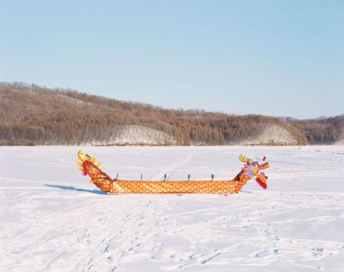 A traditional Chinese dragon boat sits in the frozen Yichun river in Yichun, Heilongjiang province. Yichun ...