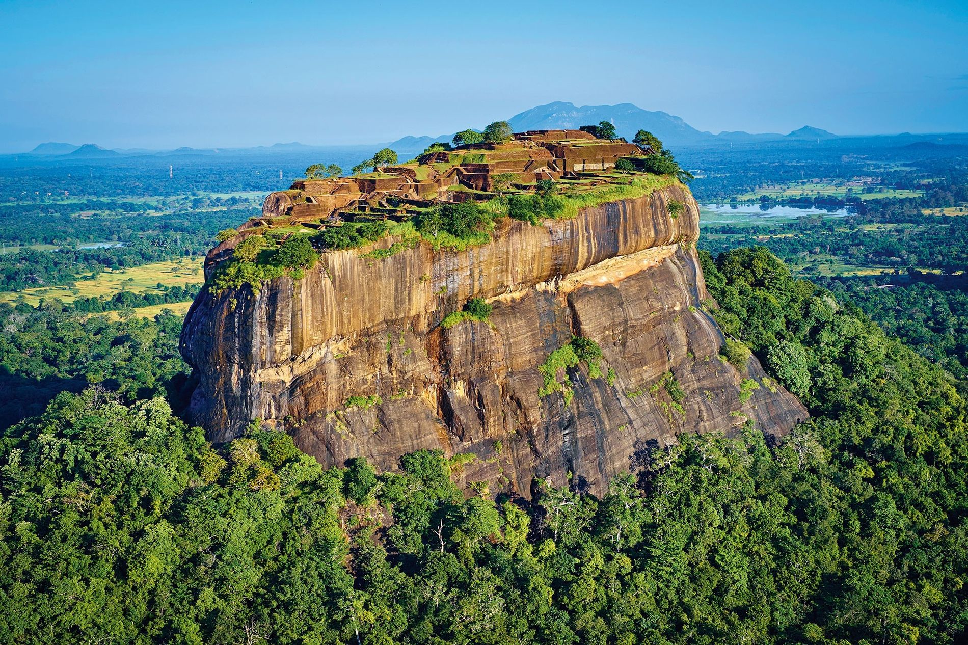 Jungle swathes the eastern face of the Sigiriya rock, topped with the citadel built by King Kashyapa I in the late fifth century A.D. in central Sri Lanka.