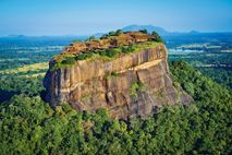 Jungle swathes the eastern face of the Sigiriya rock, topped with the citadel built by King ...