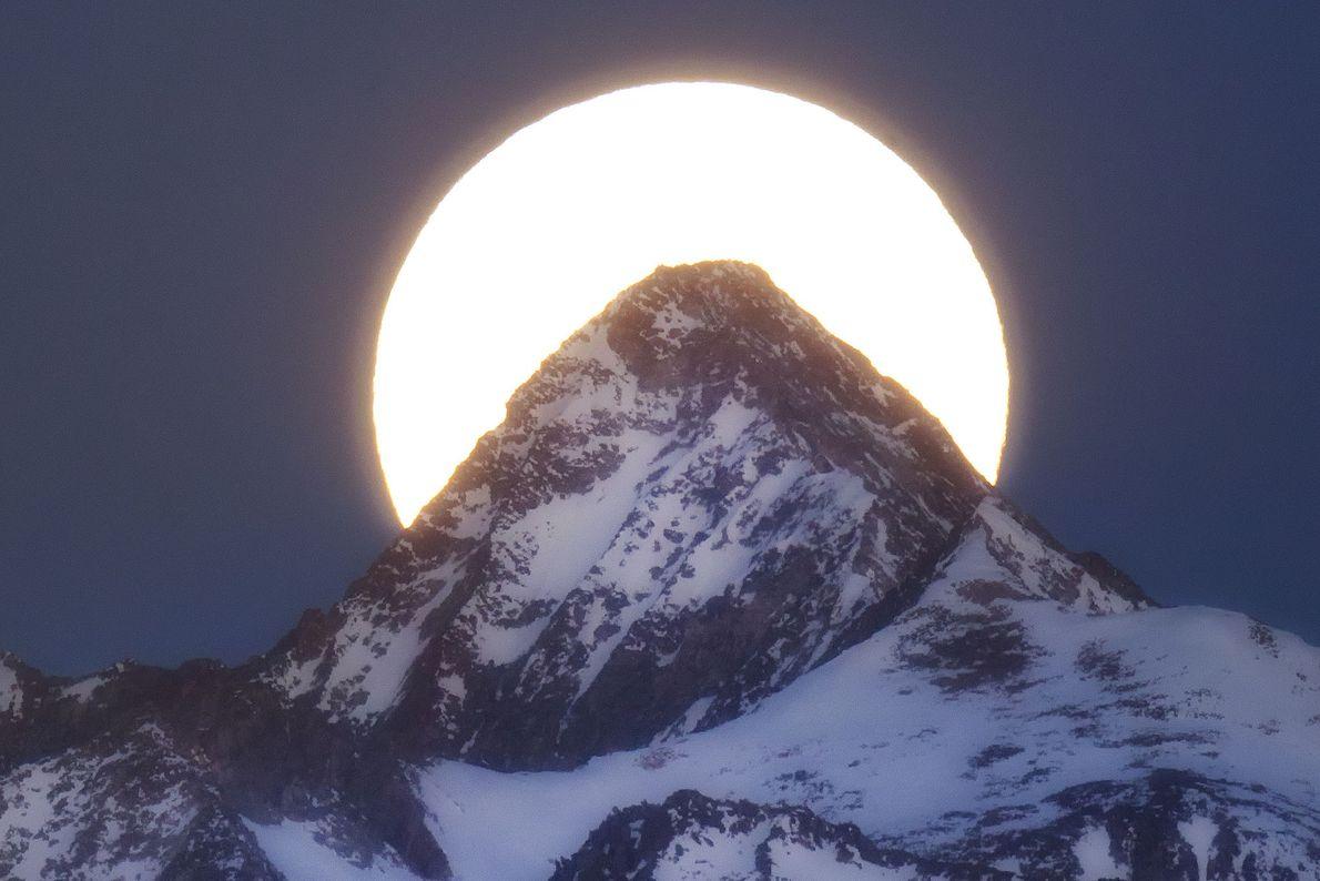 A supermoon sets behind Capitol Peak in Colorado.