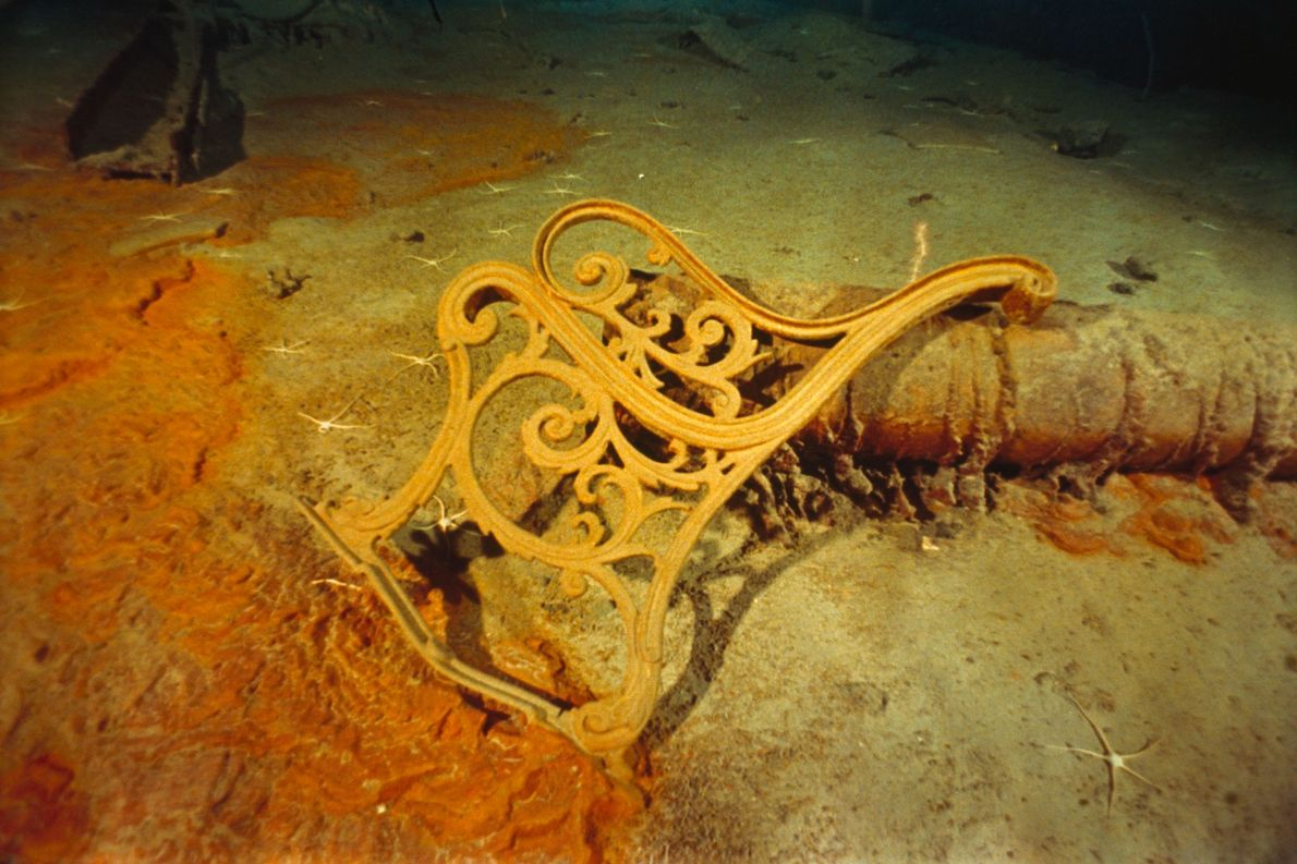 The frame of a metal deck bench frame rests amid the wreckage of the Titanic.