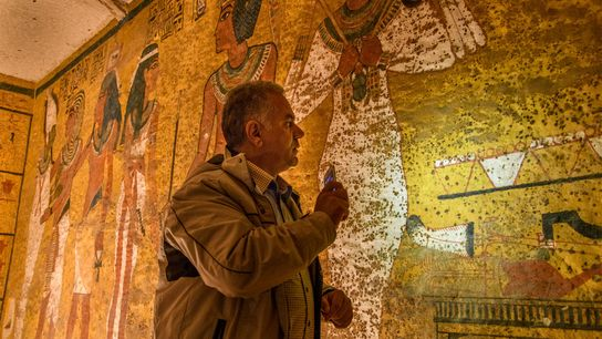 Professor Mamdouh El Damaty examines the north wall of the tomb during the third radar scan.