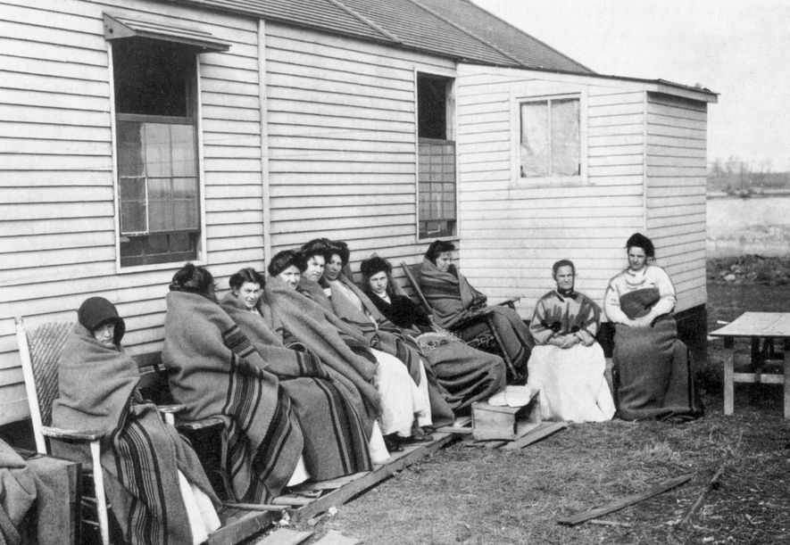 Mallon (fourth from right) was quarantined with other inmates for more than a third of her ...