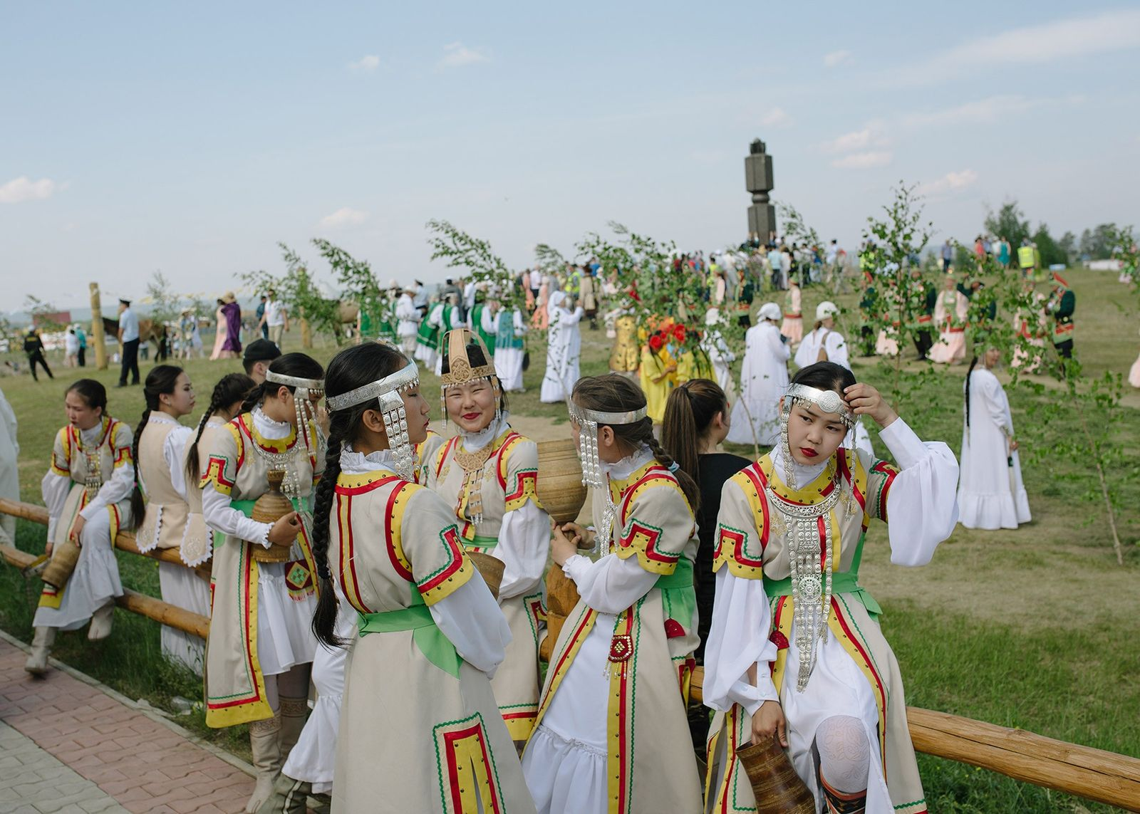 A young women's dance ensemble prepares for the opening ceremony at Us Khatyn's Ysyakh, which draws ...