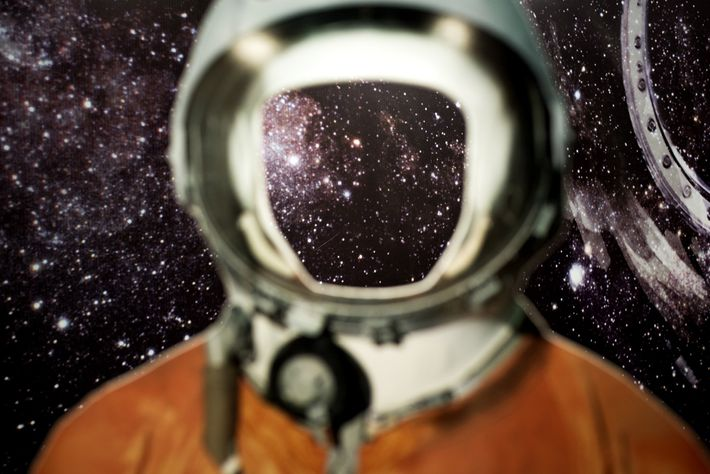 A life-size cardboard model of Gagarin's training spacesuit—with a hole where the face would be—makes a ...