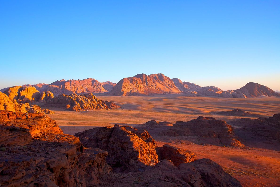 With its rugged sandstone cliffs and vermillion hue, Jordan's Wadi Rum is one of the planet's ...