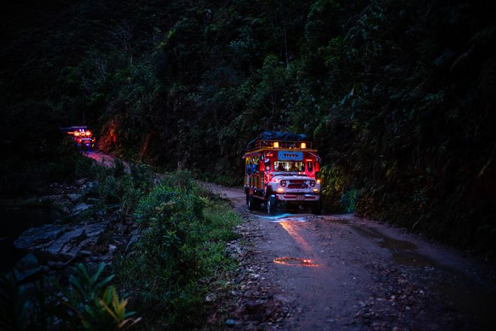 A rural bus called a 'Chiva' carries the researchers and former rebels from FARC from Anorí ...