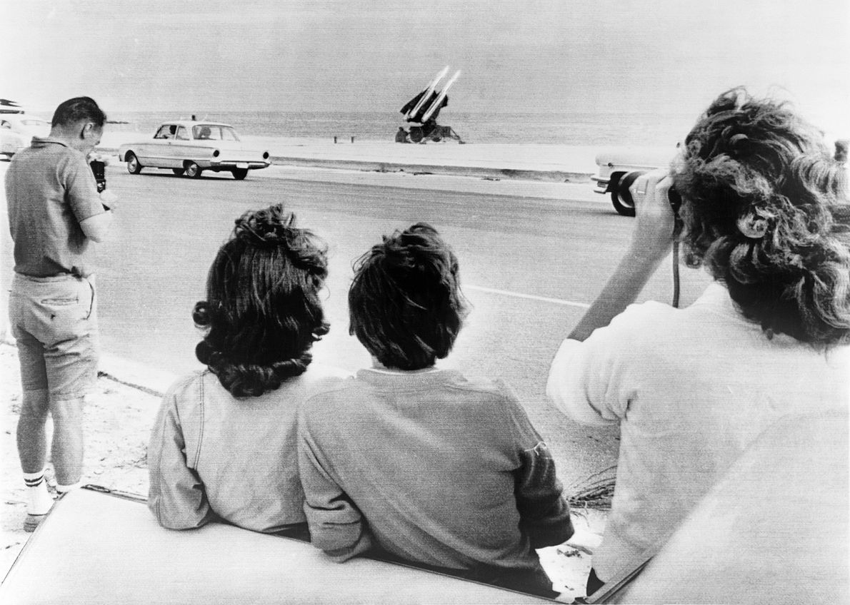 People gather on George Smathers Beach in Key West, Florida to see the Army's Hawk anti-aircraft ...