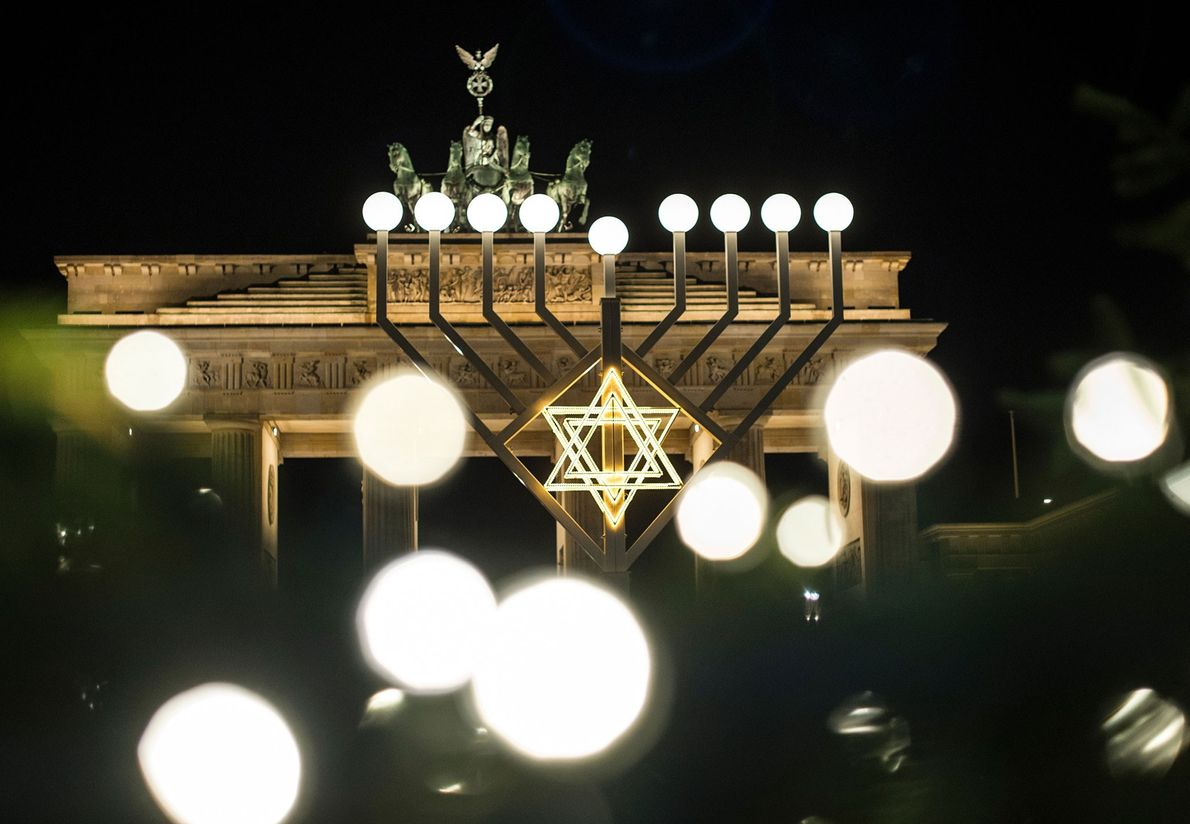 Public menorahs, like this one in front of the Brandenburg Gate in Berlin, Germany, are a ...