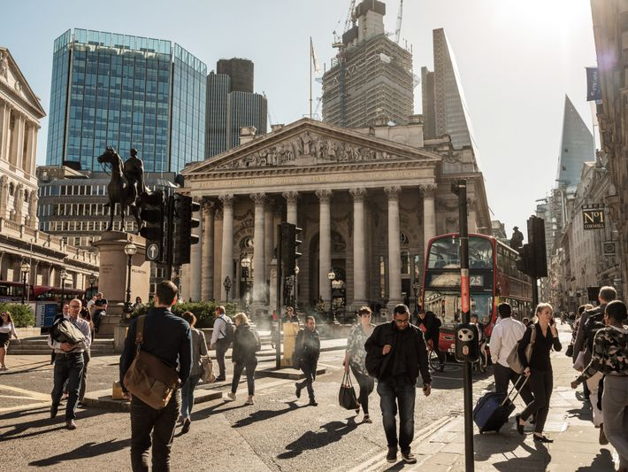 Pedestrians converge at Bank Junction in the City of London, the original financial district. The Royal ...