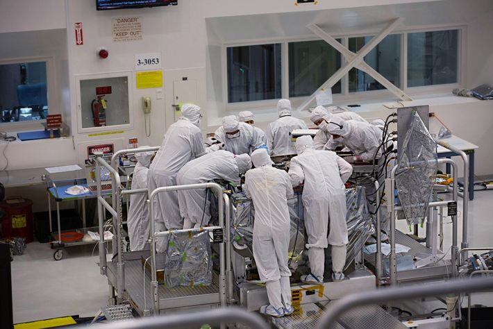 Scientists work on the Mars2020 rover inside the Spacecraft Assembly Facility at NASA's Jet Propulsion Laboratory ...