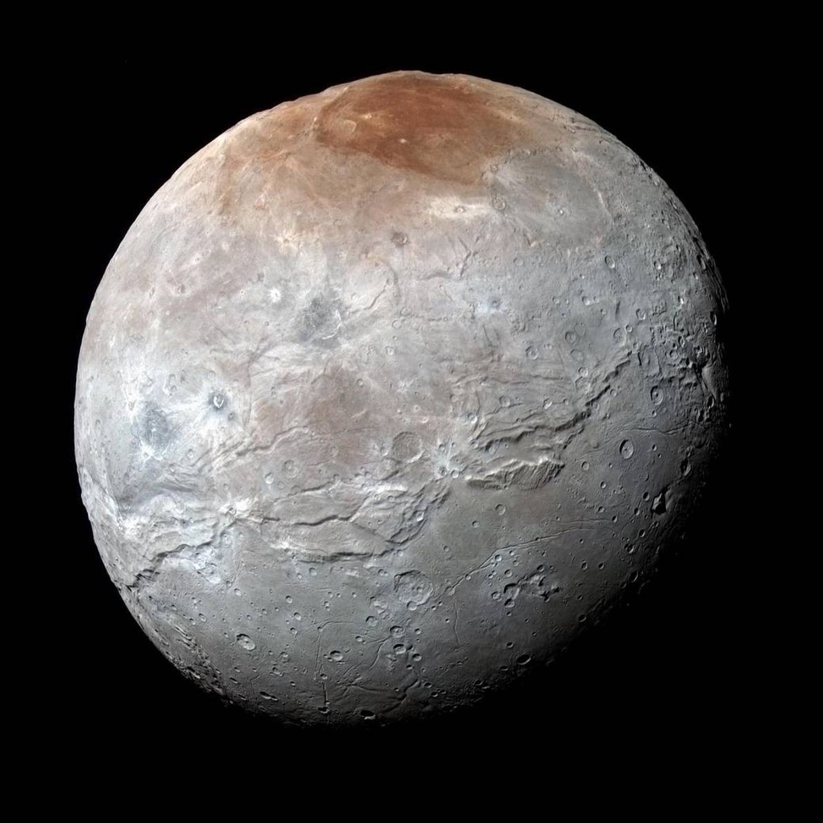Pluto's largest moon Charon, seen here in an enhanced color image from New Horizons, has a ...