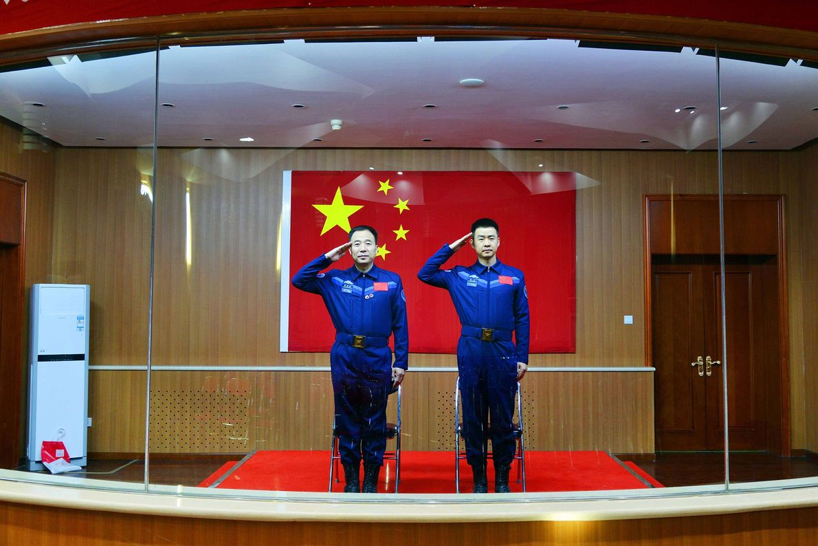 Chinese astronauts Jing Haipeng (left) and Chen Dong meet the media at the Jiuquan Satellite Launch ...