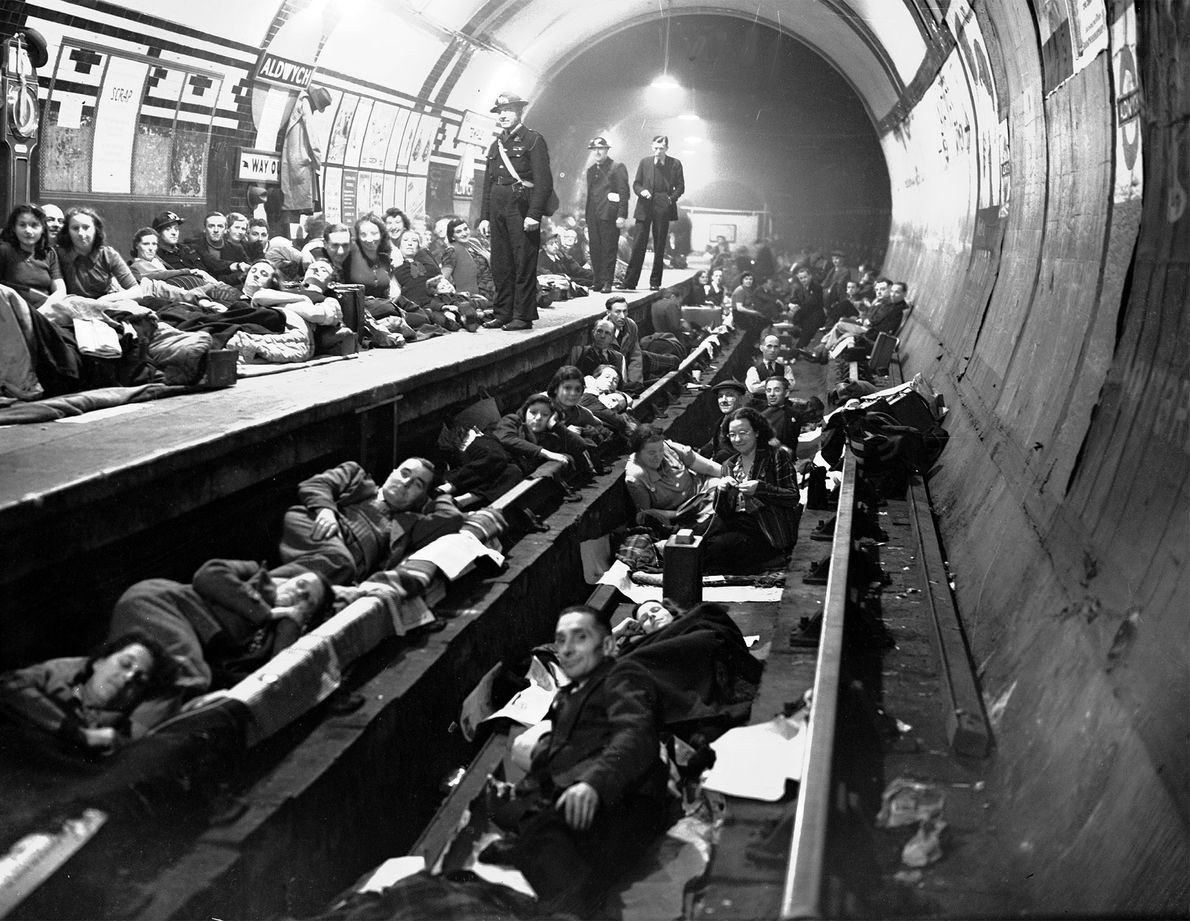 Londoners sleep on an Underground train platform during an all-night raid. Many could not make it ...