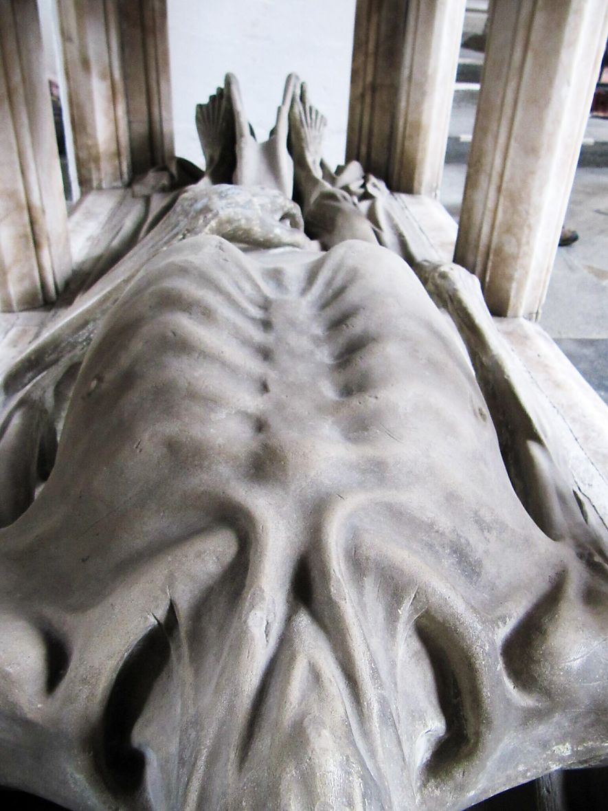 Ribs and neck muscles are visible on John Fitzalan's carved cadaver.