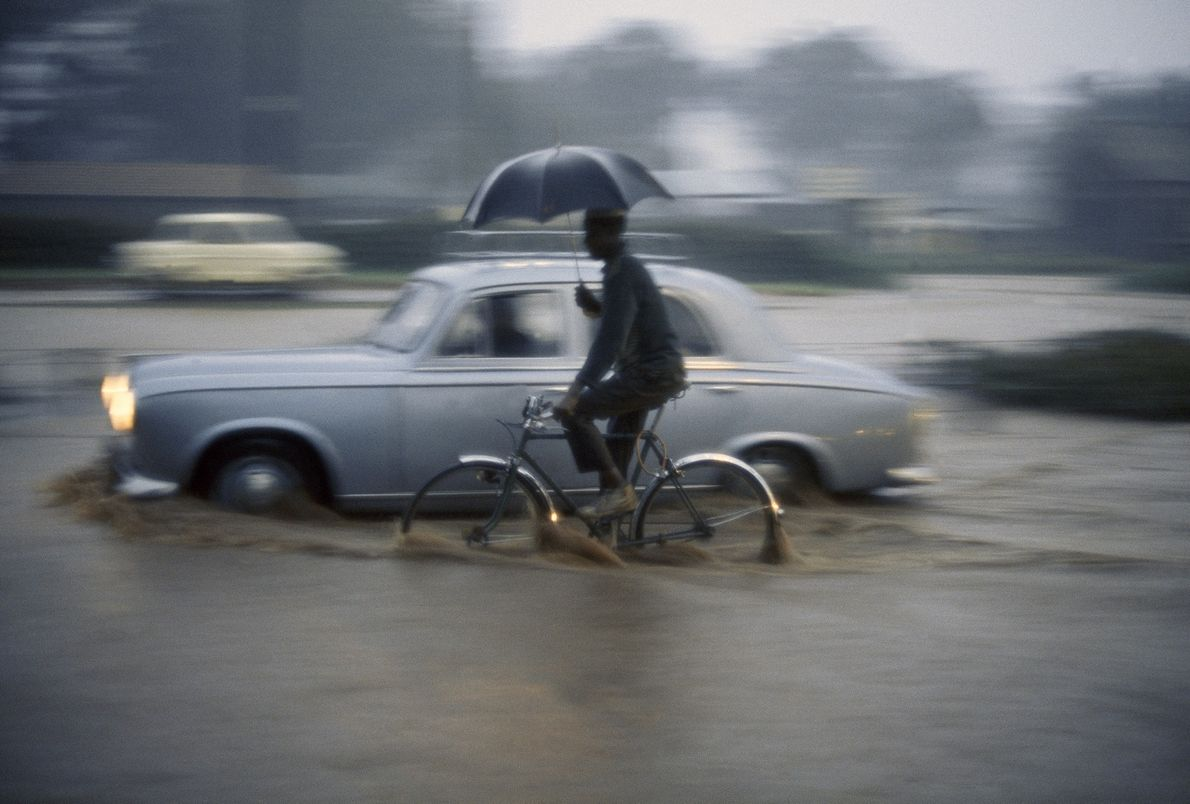 A man rides through 10 centimetres (four inches) of rain in downtown Nairobi, Kenya, in this …