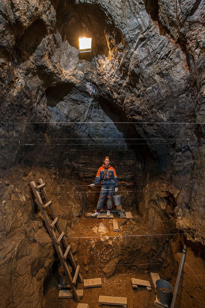Student Zoya Gudkova takes a break while excavating in Denisova cave, in Siberia's Altai Mountains.