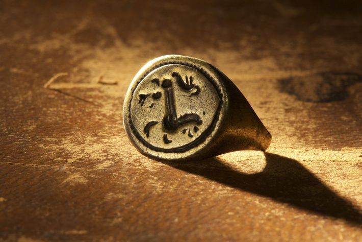 A gold signet ring excavated from the Cape Creek site on Hatteras Island, engraved with a ...