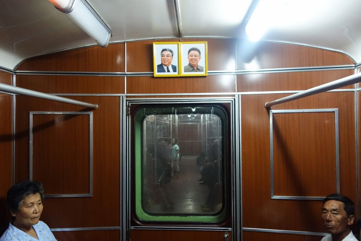 Portraits of father and son Supreme Leaders Kim Il Sung and Kim Jong Il hang in ...