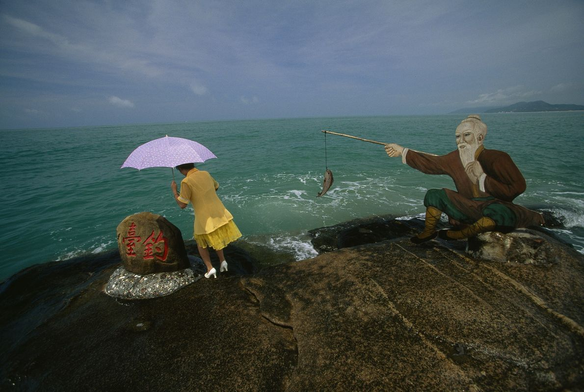 A tourist approaches China's southernmost point in Hainan, China, at the edge of the South China ...