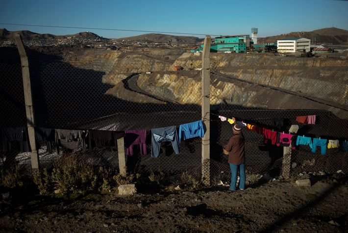 Clothes are hung out to dry along a fence that separates the Yanacancha neighbourhood of Cerro ...