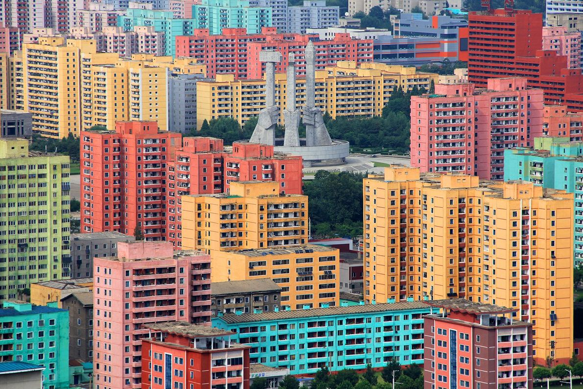 Colorful buildings surround the Monument to Party Founding in North Korea's capital city. The monument recognizes ...
