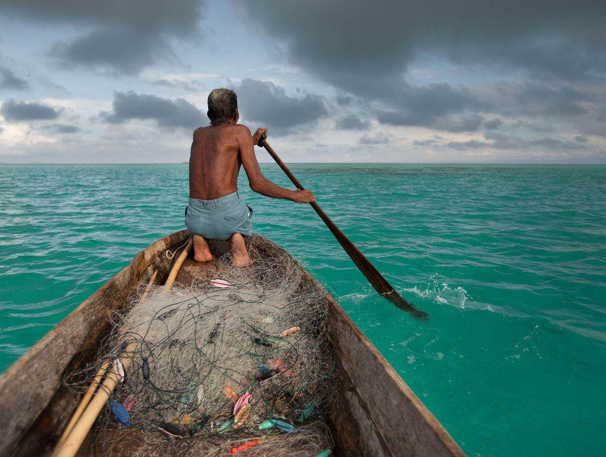 A Bajau fisherman named Sahad sails off Bodgaya Island.