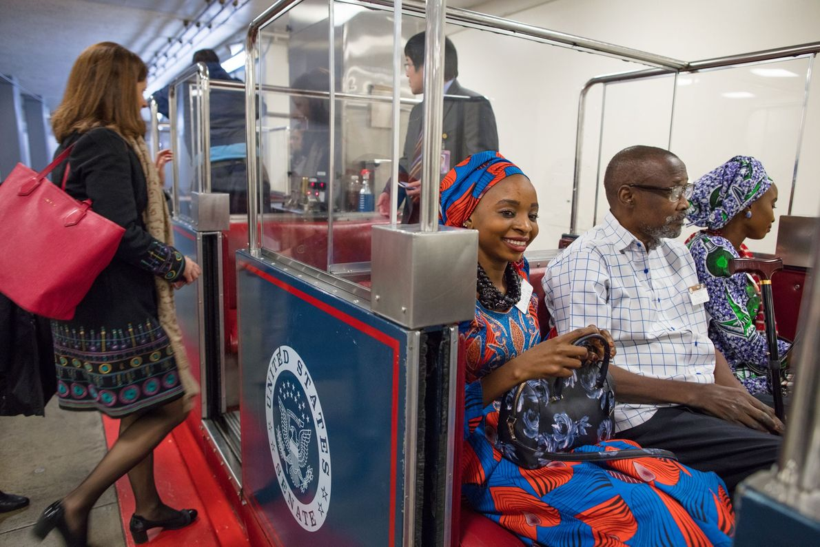 Hauwa and Ya Kaka ride the special Russell Subway train to the U.S. Capitol Building with ...
