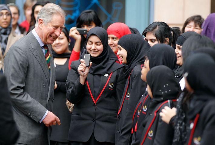 Prince Charles laughs with Muslim students in Bradford, the city in northern England where author Jerry ...