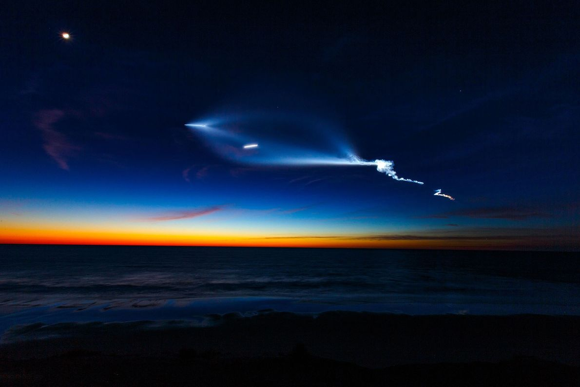 A SpaceX Falcon 9 rocket carrying 10 communications satellites illuminates the Southern California sky above the ...