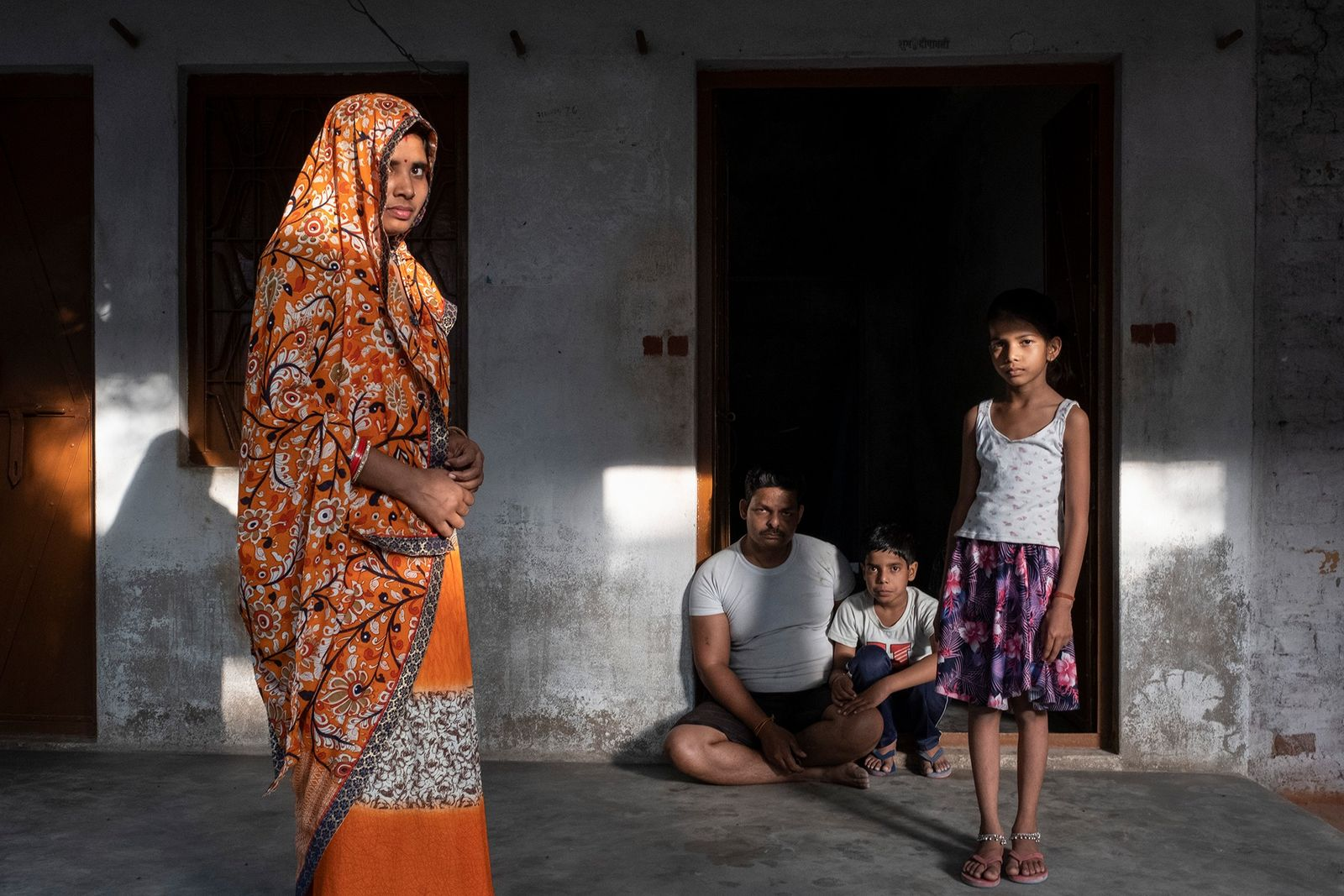A family outside their home in Basanta Khera, India. The father, Atul Patel, worked as a ...