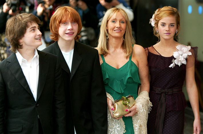 J.K. Rowling poses with Daniel Radcliffe, left, who plays Harry Potter, Rupert Grint, second left, who ...
