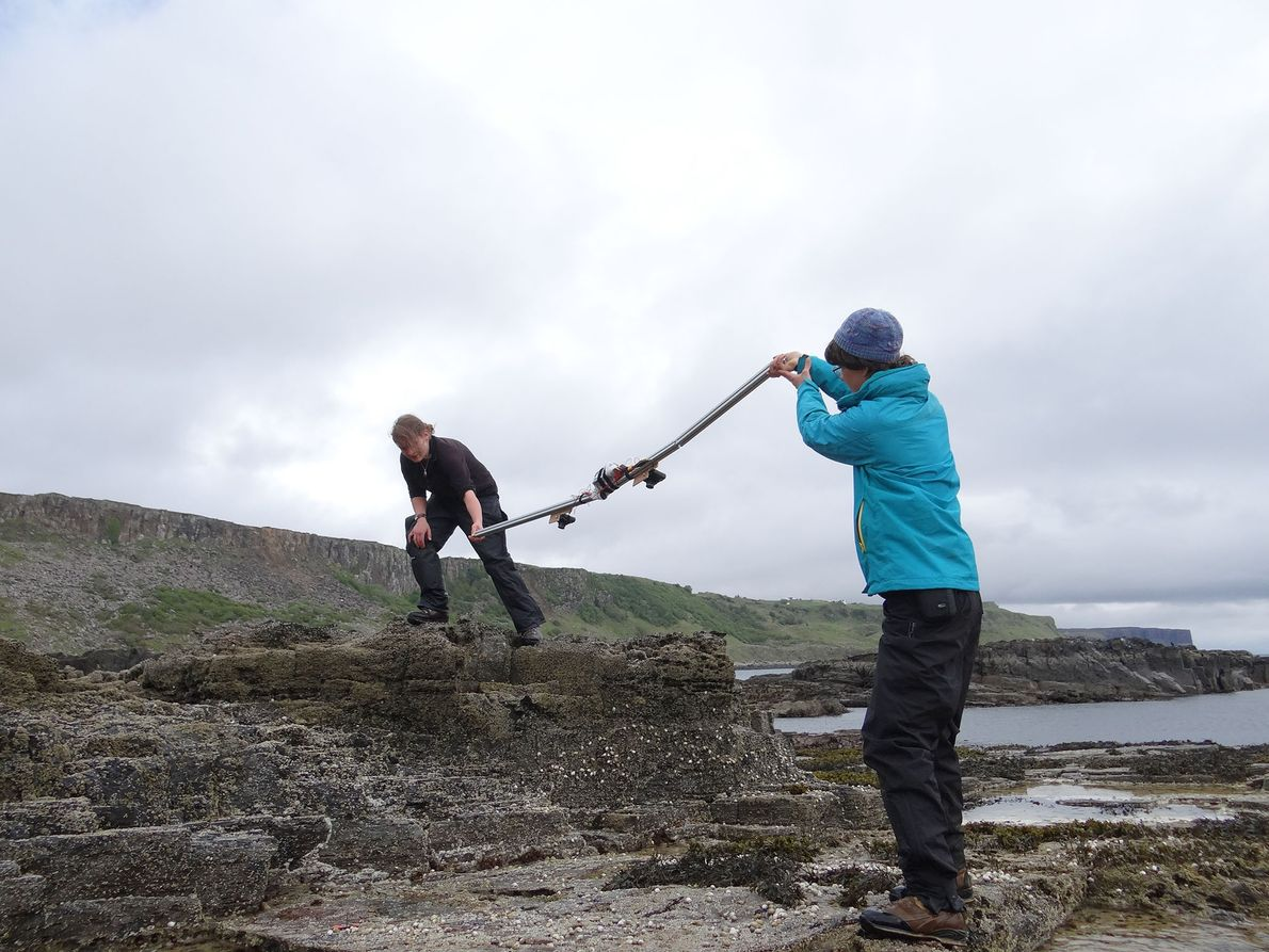 Amelia Penny and Shasta Marrero using a homemade 'intervalometer' to collect digital images of the tracksite ...