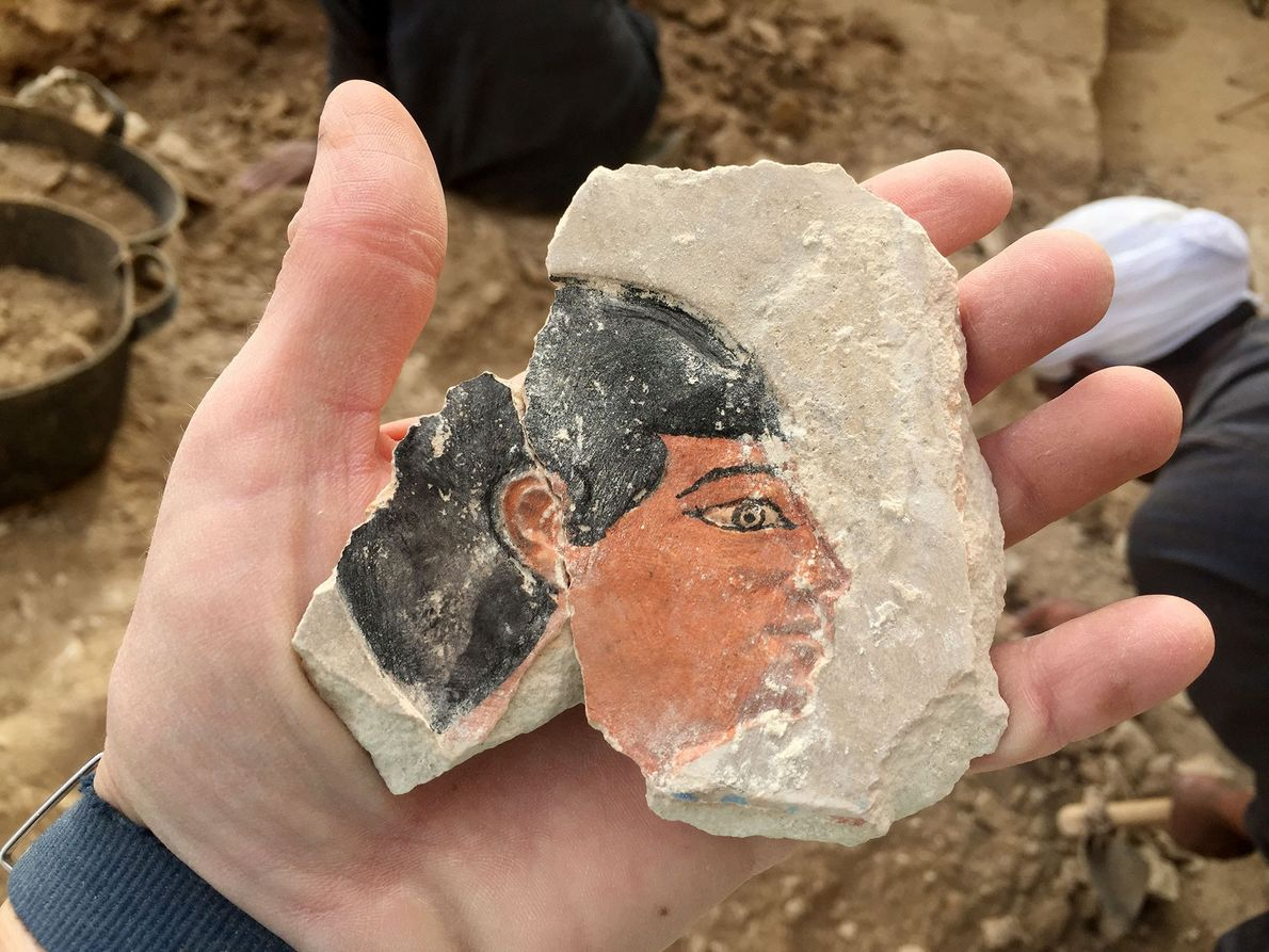 The team found this brightly painted face in Intef's tomb while excavating the structure in December ...
