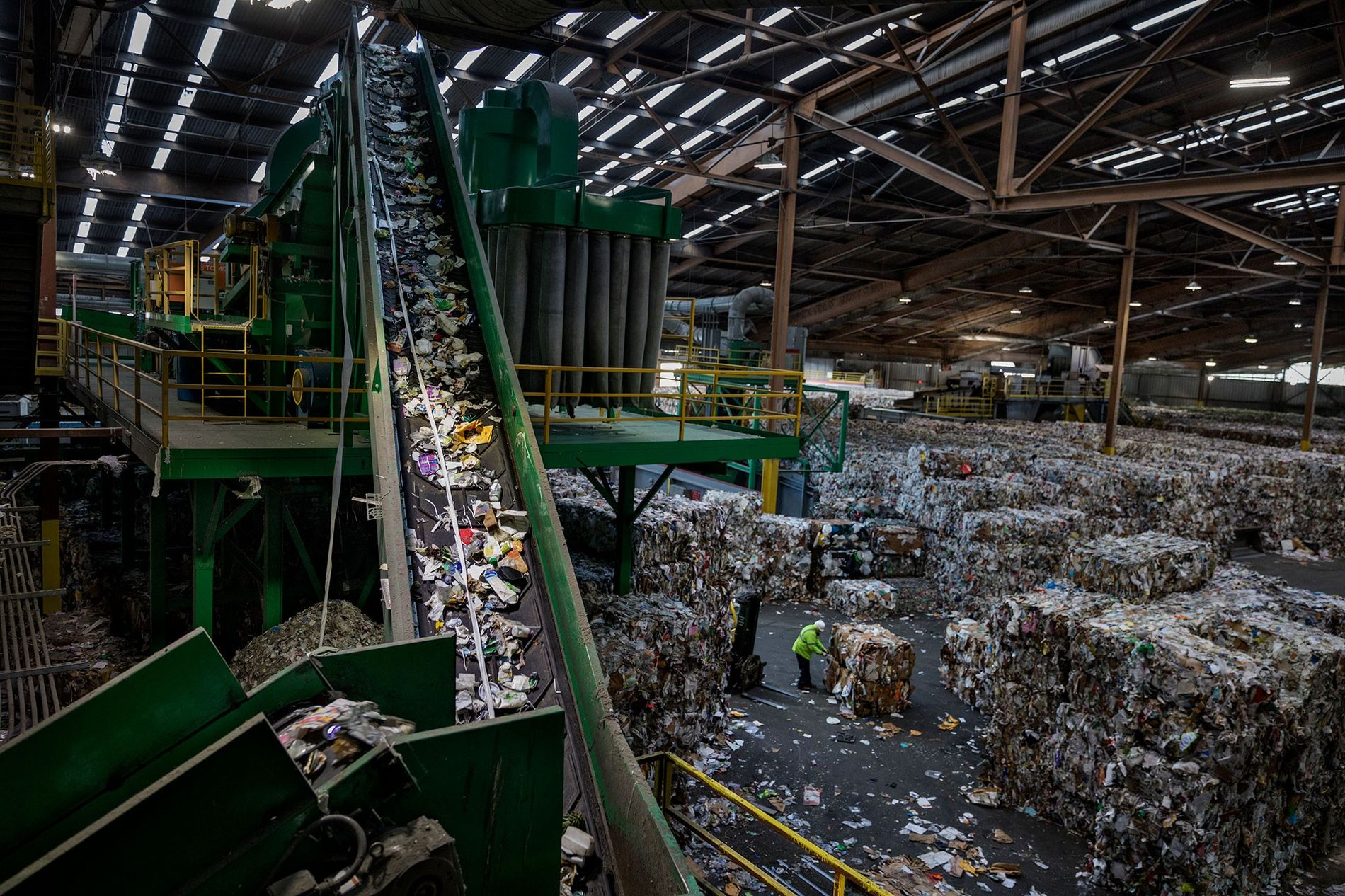 A conveyor belt carries mixed plastic to a sorter in a recycling facility in San Francisco, ...