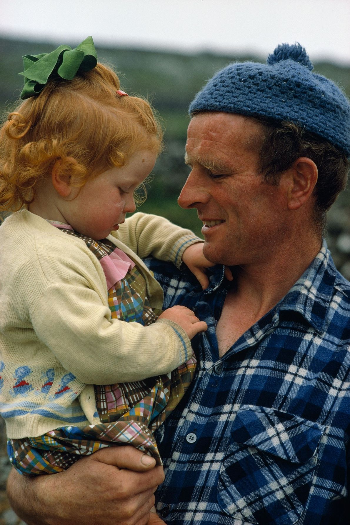 A fisherman cradles his daughter on Inishmaan Island, one of Ireland's Aran Islands, in the 1970s.