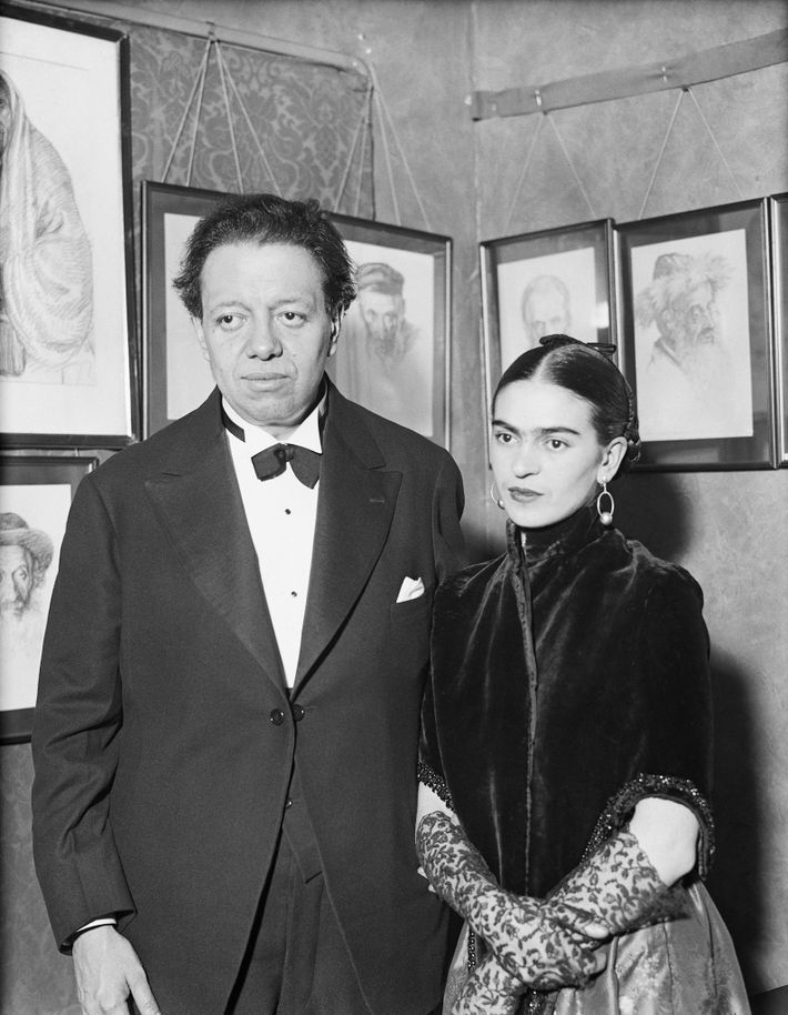 Artists Diego Rivera and Frida Kahlo visit an art gallery exhibition of Jewish portraits by Lionel ...