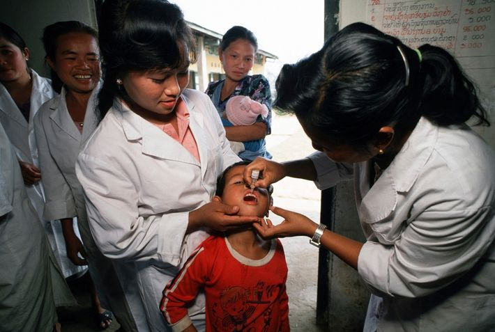 Health workers in northern Laos inoculate children in 1991 as part of a UNICEF-sponsored health drive ...