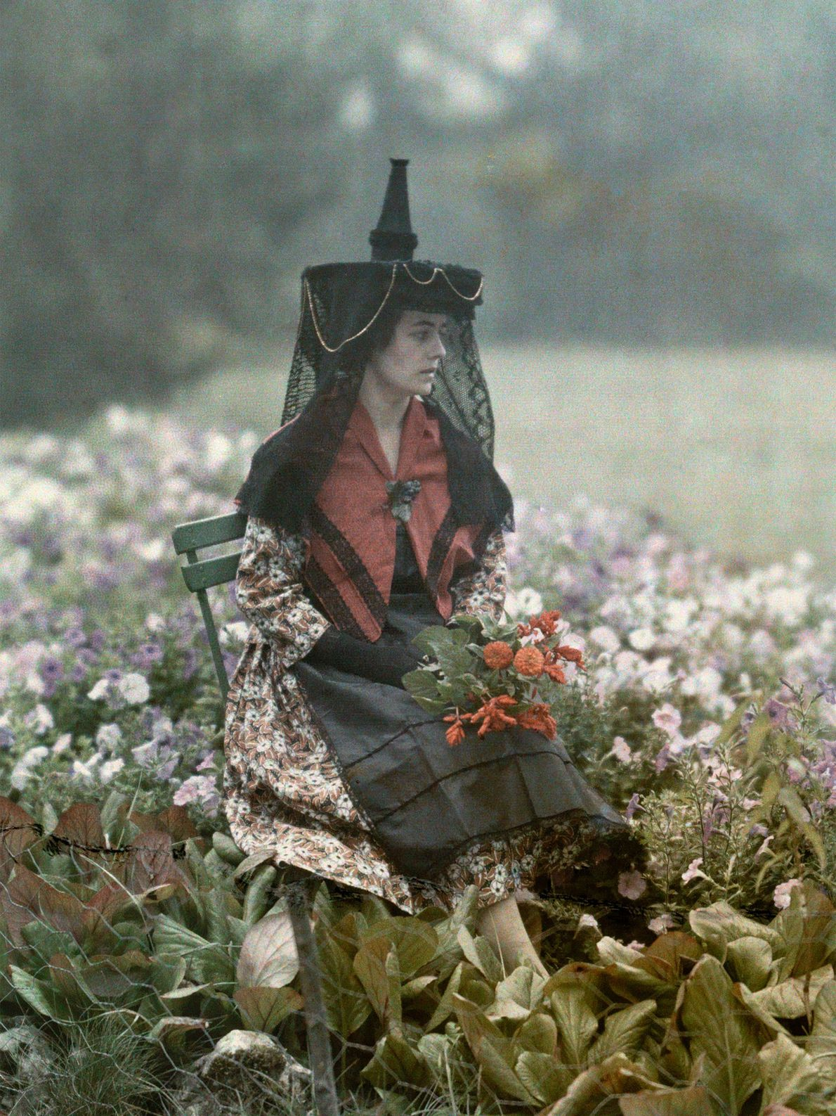 A woman in Saone et Loire, France, poses in the traditional headdress of the Burgundians in ...