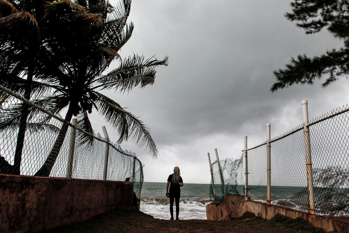 A woman looks at heavy surf as Hurricane Irma approaches Luquillo, Puerto Rico on September 6.
