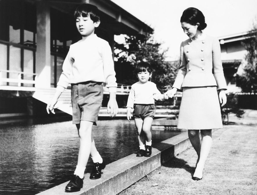 Princess Michiko walks with her two sons, Prince Hiro and Prince Aya on Oct. 25, 1968. ...