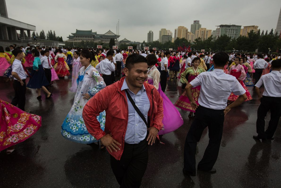 U.S. passport holder Joe Lim dances with North Koreans during a traditional dance in Pyongyang.