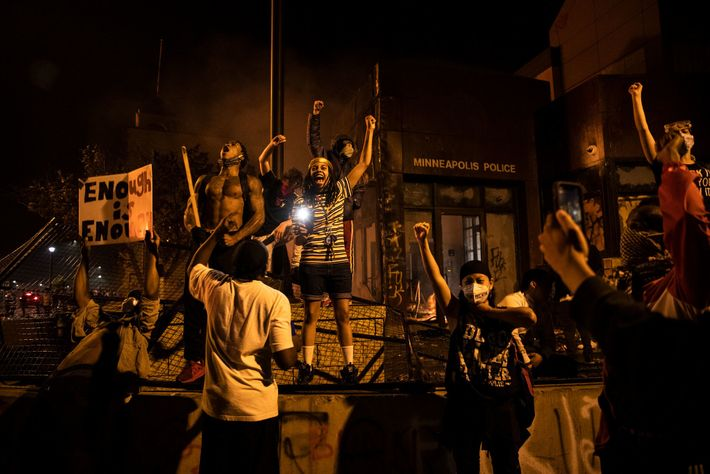 Demonstrators set fire to the 3rd Precinct, cars in the street, and nearby buildings on Thursday ...