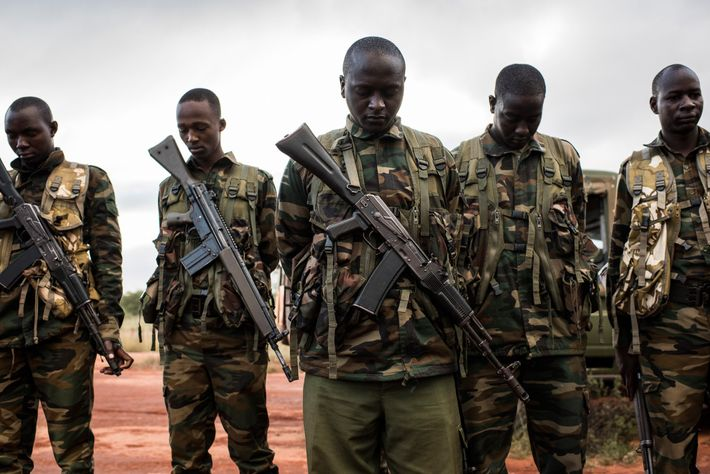 Rangers with the Kenya Wildlife Service pray before an elephant-collaring operation in Tsavo West National Park. ...