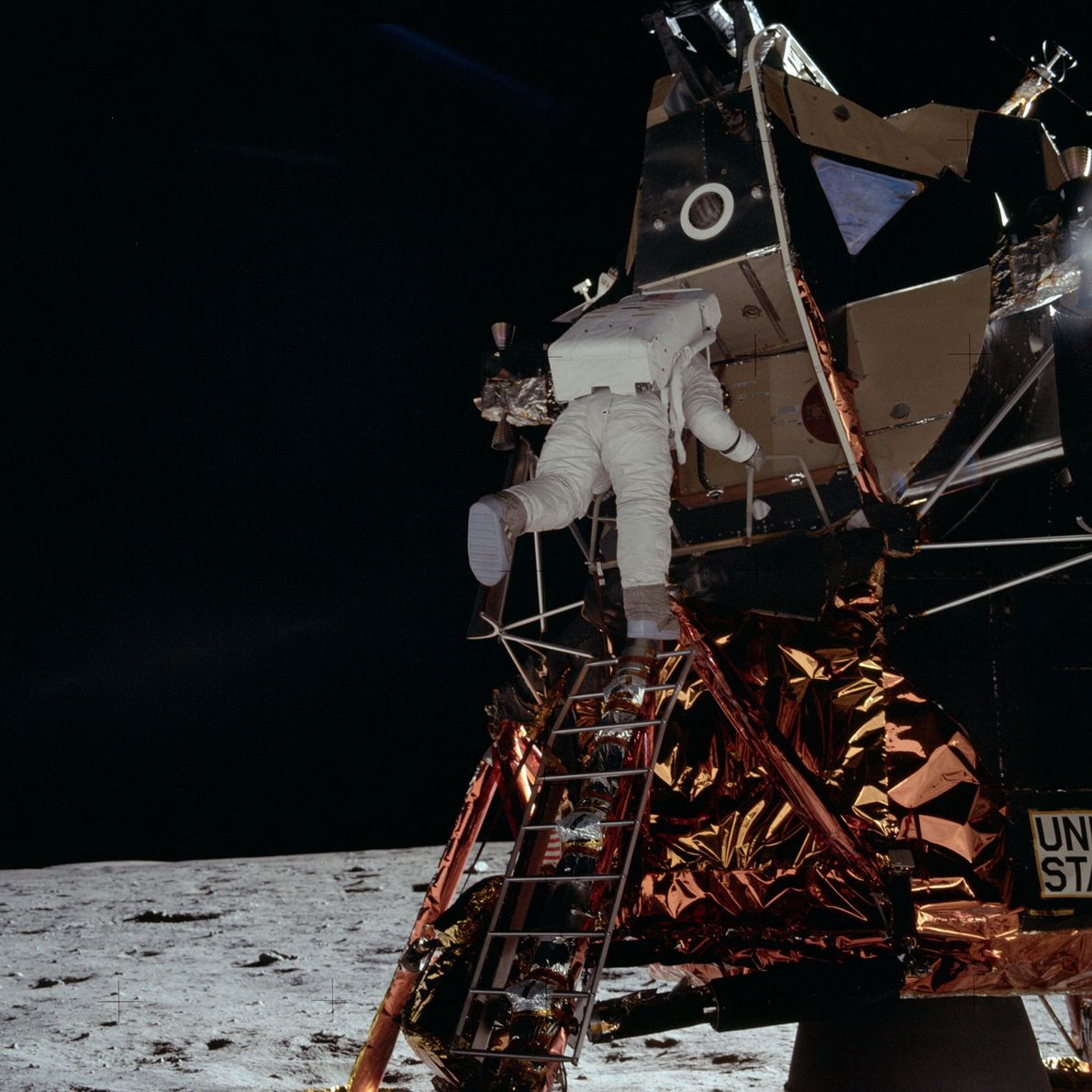 Apollo 11 astronaut Buzz Aldrin climbs down the ladder of the Eagle to the Moon's surface ...