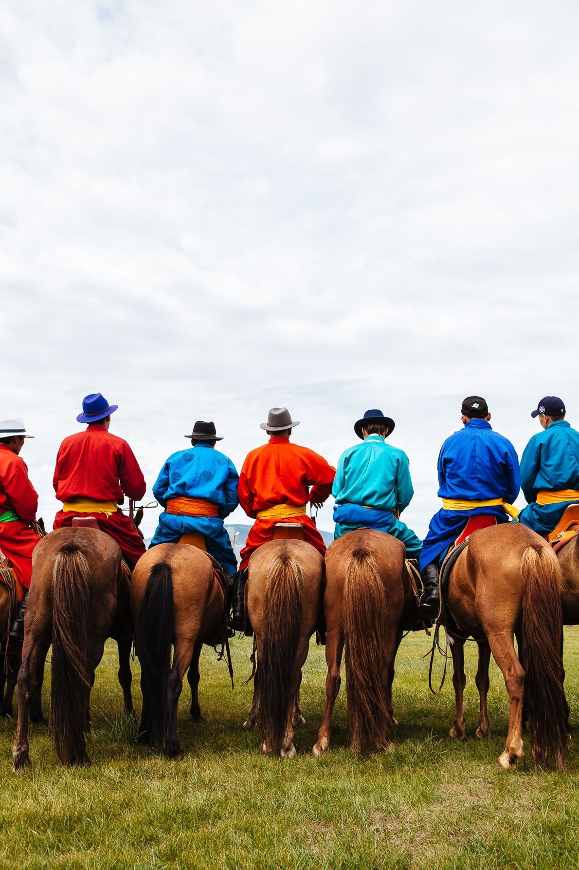 """""""A group of men sit on their horses during the opening ceremony of Nadaam Festival near ..."""