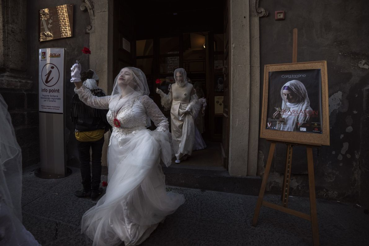 """On the occasion of the Sant'Agata celebrations [in Siciliy], young women dressed as brides known as ..."