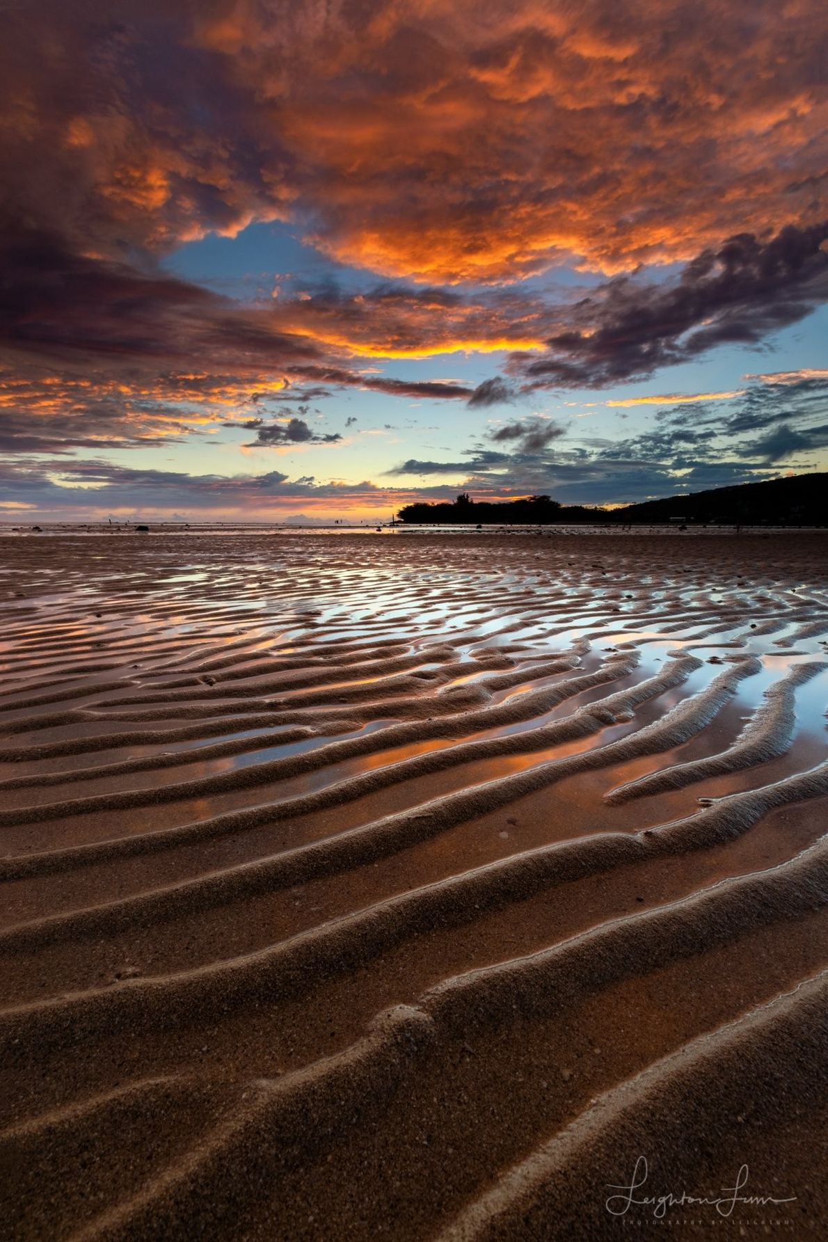 """Your Shot photographer Leighton Lum went to the beach in Honolulu, Hawaii at low tide. """"The ..."""