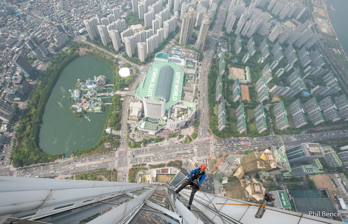 Your Shot photographer Phil Bence documented this moment of a climber scaling the Lotte Tower, which ...